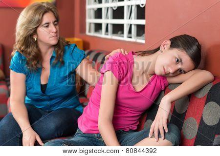 Mother tries to comfort her sad teenage daughter