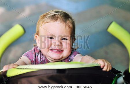 Baby Girl Having Fun In The Stroller