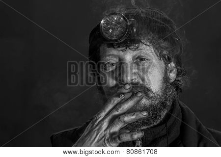 Portrait Of Midage Man With Beard Smoking Cigar