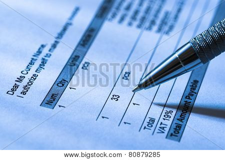 Close-up Of A Person Filling Invoice Paper With Pen poster