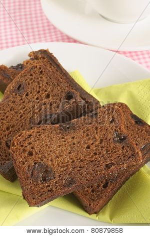Malt Loaf a heavy soft fruit loaf made with malt extract also known as raisin bread or harvo poster
