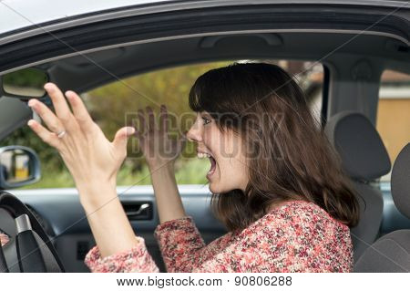 Angry Young Woman Driving In Car