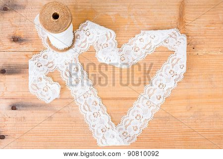 Lace on a wooden background