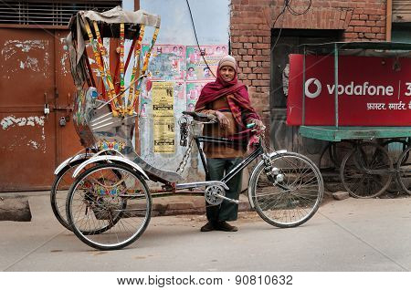 Trishaw Driver On The Street Cold Foggy Morning In Winter At Varanasi
