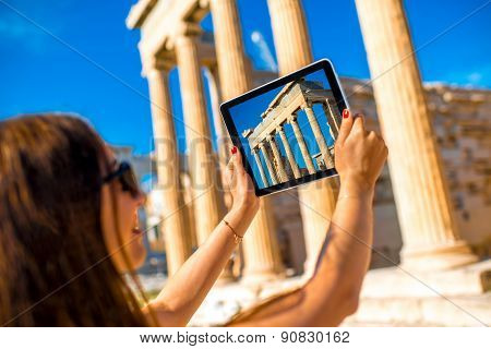 Woman photographing Erechtheum temple in Acropolis