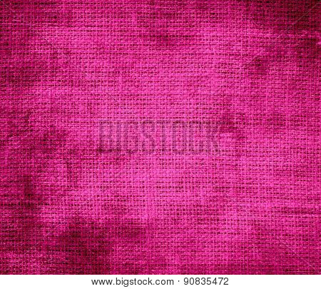 Grunge background of hot pink burlap texture