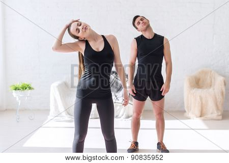 Couple fit woman and man working warm up neck at gym fitness, sport, training lifestyle concept