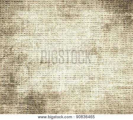 Grunge background of bisque burlap texture