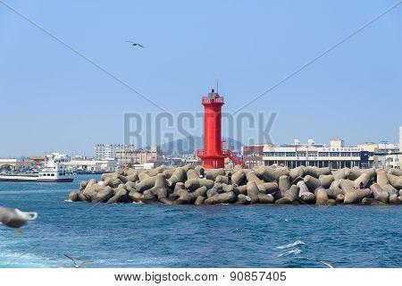 Jeju-do, Korea - April 10, 2015: Red Lighthouse On A Seawall