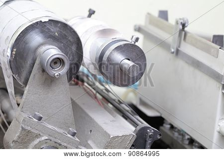 Rolling Machine With Paper In Printing Workshop