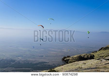 Paragliders at clear blue sky