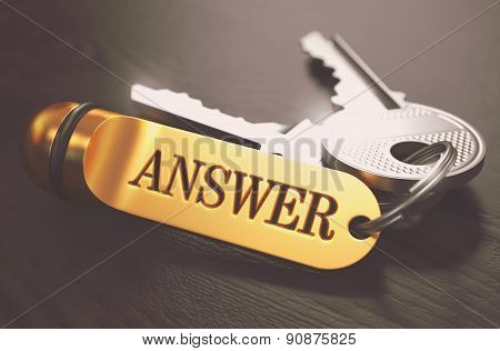 Answer - Bunch of Keys with Text on Golden Keychain.