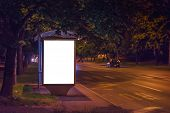 Blank Bus Station Billboard at Night as Copy Space Ready for Mock Up Design poster