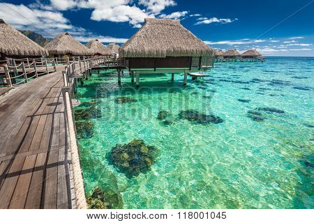 Traditional over water villas on a tropical lagoon of Moorea Island, Tahiti