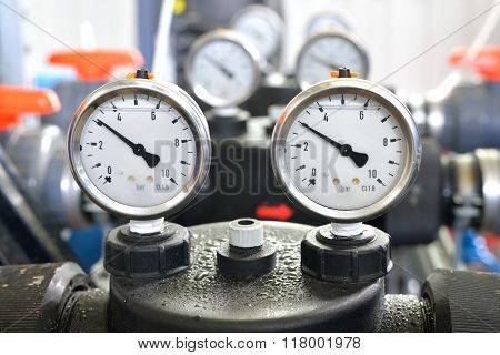 Industrial Barometers And Water Pipes In Boiler Room