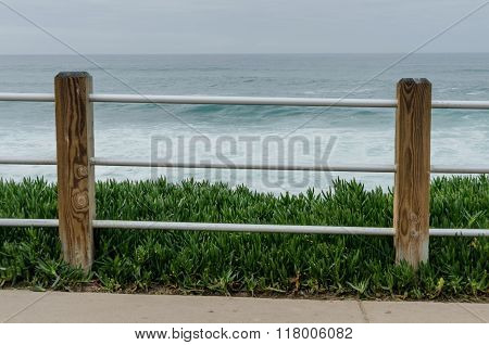 Fence In Front Of Pacific Ocean