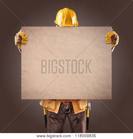 construction worker with information posters on a brown backgrou