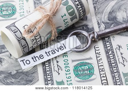 Money And Business Idea, The Dollar Bills Tied With A Rope, With A Sign On Key Fob- To The Travel