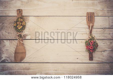 Wooden background with kitchen utencils
