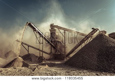 Industrial background with working gravel crusher outdoors poster