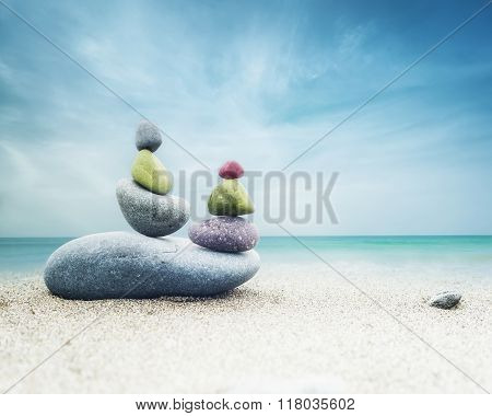 Balancing Zen Stones Pyramid On Sand