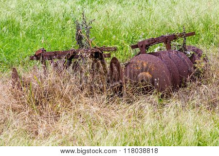 Rusty Old Texas Metal Farm Equipment In Field