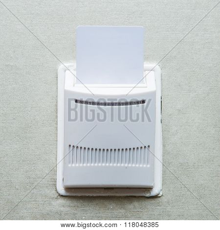 Electronic lock on door with white key card
