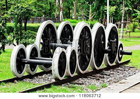Gear train various sizes on tracks in the garden