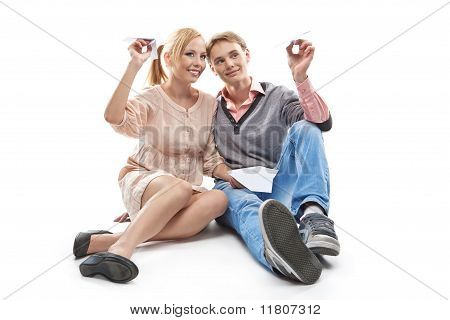 Happy Couple Throwing A Paper Plane
