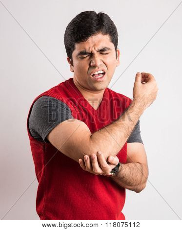 indian man having elbow pain, asian man with elbow pain, indian boy and elbow injury, elbow fracture