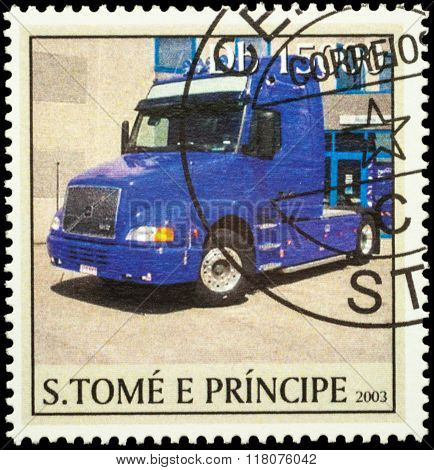 Blue Truck On Postage Stamp