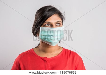 indian lady with face mask, asian lady with face mask, indian lady and swine flue, isolated on white