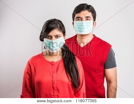 indian man and indian lady wearing face mask, asian couple and face mask, indian couple and green ma