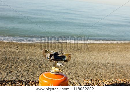 portable gas burner on the beach camping stove poster