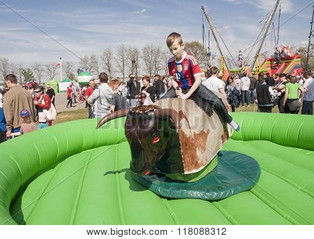 Unidentified Boy Playing Bull Riding Toy