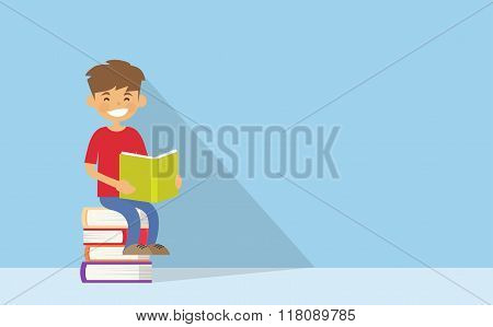 School Boy Reading Sitting on Stack Of Books