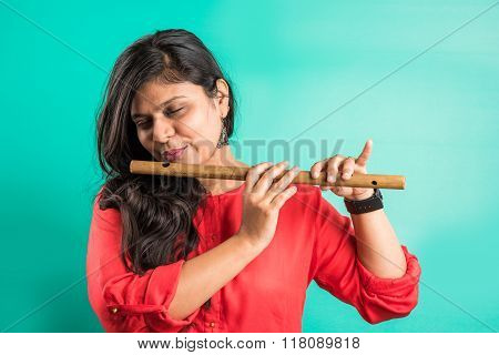 pretty indian lady playing flute, indian girl playing flute, pretty asian girl playing flute, asian
