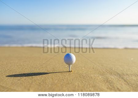 Golf Ball On A Tee At A California Beach With White Wave in Pacific Ocean In Pacific Ocean