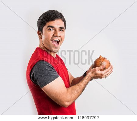 happy indian man holding piggy bank of money box made up of clay, clay money box & asian man, isolat