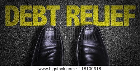 Top View of Business Shoes on the floor with the text: Debt Relief