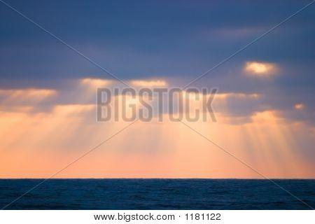 Golden Sun Beams At The Beach