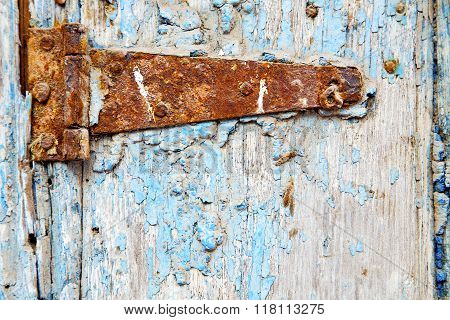 Morocco In  Old Wood  Facade Home And Rusty Safe Padlock