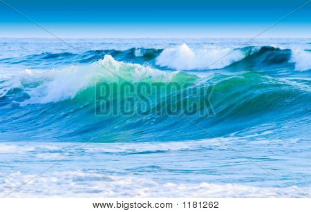 blue sky blue white and green highlighted costal waves poster