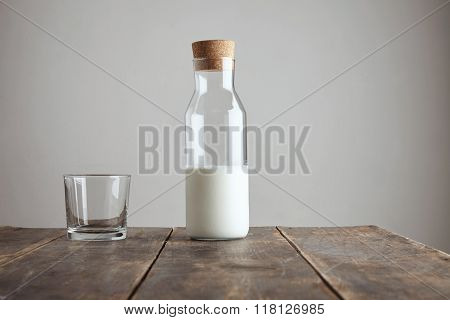 Bottle With Milk Near Rox Isolated On Table