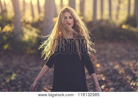 Young Blonde Woman Dancing In Poplar Forest