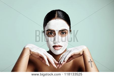 Woman's Portrait Making Daily Facial Routine