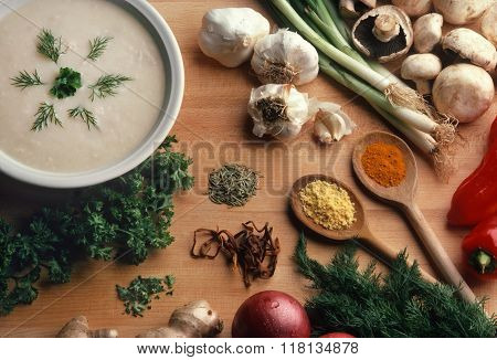 Creamy Soup With Ingredients On Butcher Block