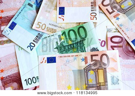 many different Euro banknotes in all colors