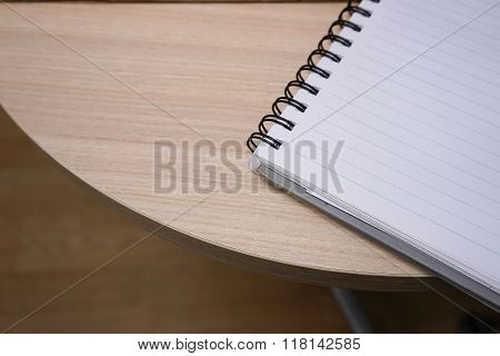 Open Notebook With Blank Pages On The Wooden Table