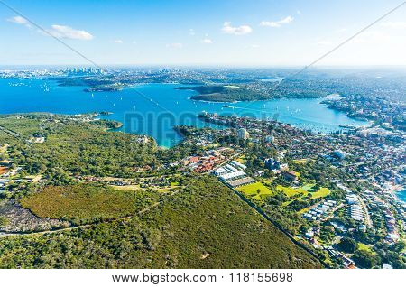 Aerial view Sydney Bay. View on Sydney harbourside suburbs from above. Aerial view on Sydney harbourside Sydney CBD Manly Parramatta and Sydney Harbour National Park